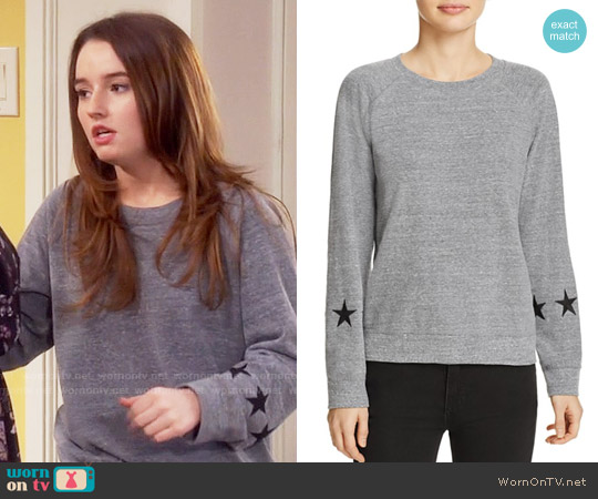 Monrow Star Sleeve Sweatshirt worn by Eve Baxter (Kaitlyn Dever) on Last Man Standing