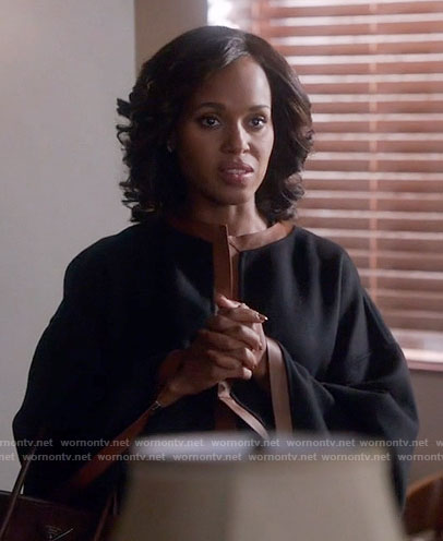 Olivia's black coat with brown leather trim on Scandal
