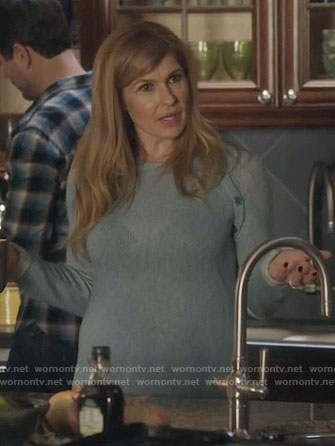 Rayna's  light blue sweater with shoulder buttons on Nashville