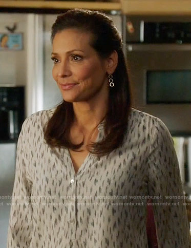Regina's white printed v-neck blouse on Switched at Birth
