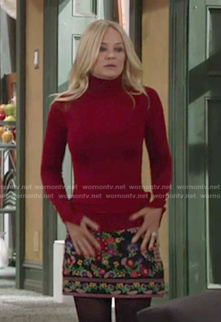 Sharon's floral embroidered skirt and red turtleneck on The Young and the Restless