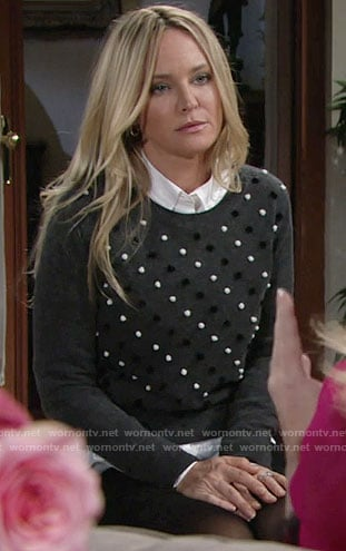 Sharon's grey sweater with black and white pom poms on the Young and the Restless