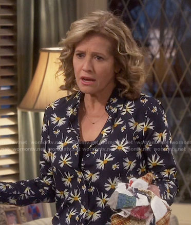 Vanessa's black daisy print shirt on Last Man Standing
