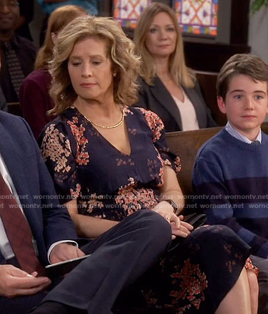 Vanessa's navy floral v-neck dress on Last Man Standing