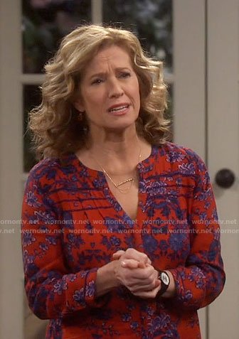 Vanessa's red floral split-neck top on Last Man Standing