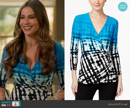 Calvin Klein Printed Faux-Wrap Top worn by Sofia Vergara on Modern Family