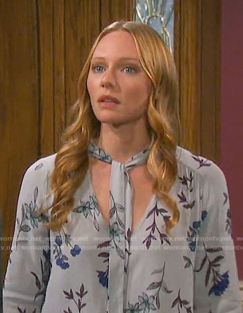Abby's grey floral tie-neck blouse on Days of our Lives