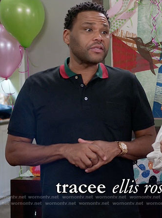 Andre's black polo shirt with red and green collar on Black-ish