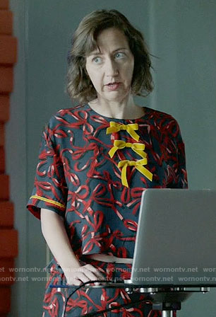 Carol's ribbon print top and pants with yellow bows on Last Man on Earth