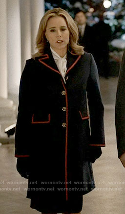 Elizabeth's navy coat with red trim on Madam Secretary