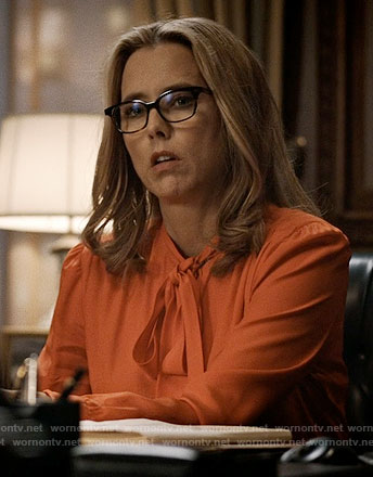Elizabeth's orange tie-neck blouse on Madam Secretary