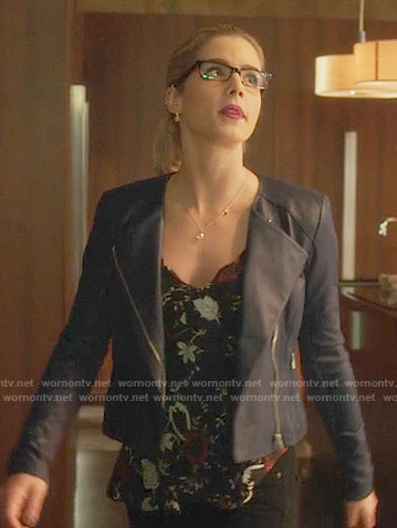 Felicity's black floral top and blue leather jacket on Arrow