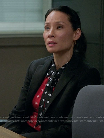 Joan's red and black bird print top on Elementary