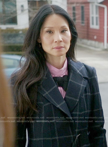 Joan's pink top with black bow on Elementary