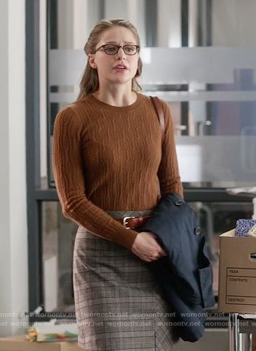 Kara's brown cable knit sweater and plaid skirt on Supergirl