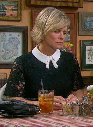 Kayla's navy lace dress with white collar and tie on Days of our Lives