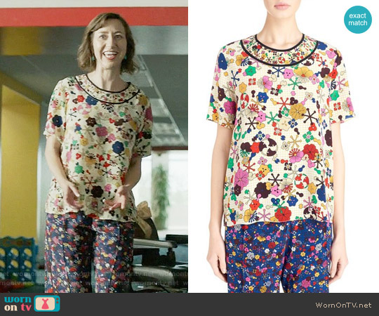 Kenzo 'Tanami Flower' Silk Crepe Top worn by Carol Pilbasian (Kristen Schaal) on Last Man On Earth