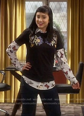 Mandy's butterfly print shirt and floral top on Last Man Standing