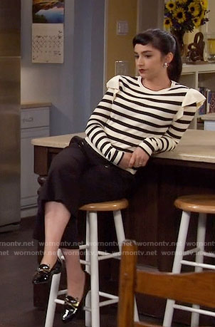 Mandy's striped sweater with ruffle shoulders and cat  flats on Last Man Standing