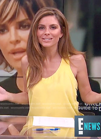 Maria's yellow dress with side cutouts on  E! News