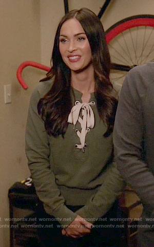 Reagan's lace-up sweatshirt on New Girl