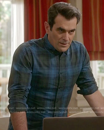 Phil's blue and green plaid shirt on Modern Family