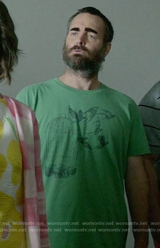 Phil's green birdcage graphic t-shirt on Last Man on Earth
