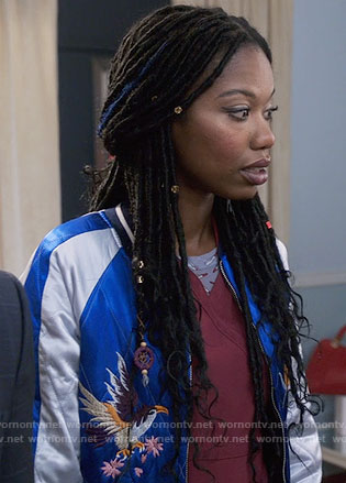 Tamra's blue embroidered bomber jacket on The Mindy Project