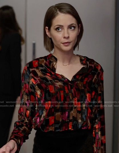Thea's black and red printed blouse on Arrow