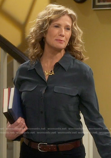 Vanessa's black blouse and gold bird necklace on Last Man Standing