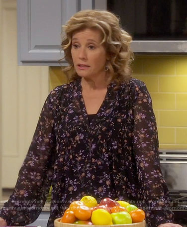 Vanessa's black floral v-neck blouse on Last Man Standing