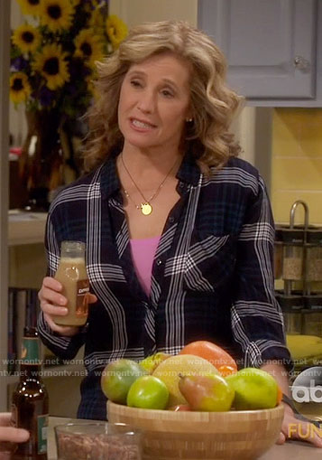 Vanessa's dark green plaid shirt on Last Man Standing