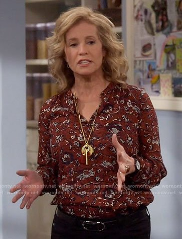 Vanessa's red printed shirt on Last Man Standing