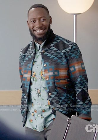 Winston's blue parrot print shirt and patterned bomber jacket on New Girl
