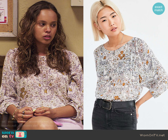 Ecote Floral Pintucked Dolman Blouse worn by Alisha Boe on 13 Reasons Why