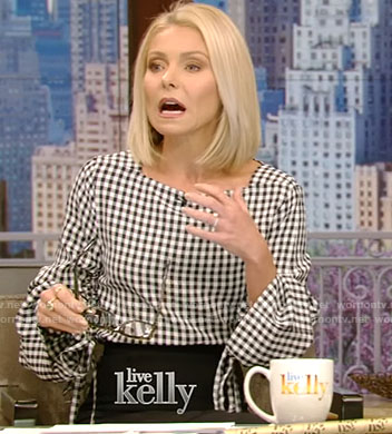 Kelly's checked top with adjustable sleeves and black skirt on Live With Kelly