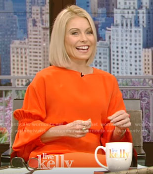 Kelly's orange balloon sleeve dress on Live With Kelly