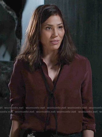 Angela's burgundy blouse with black tie neck on Bones
