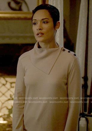 Anika's beige folded neck sweater on Empire