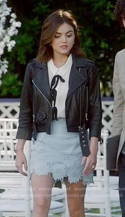 Aria's blue lace skirt, white top with bows and leather jacket on Pretty Little Liars