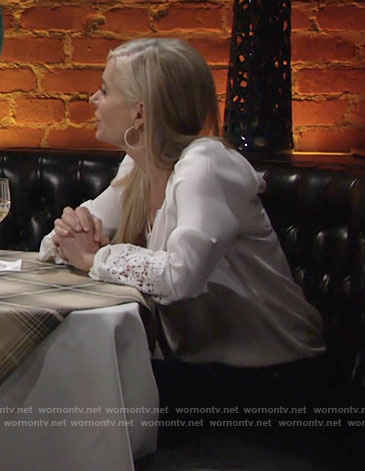 Ashley's white peasant blouse with lace sleeves on The Young and the Restless