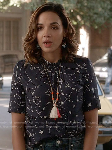 Cassandra's constellation print top and tassel jewelry on Famous in Love