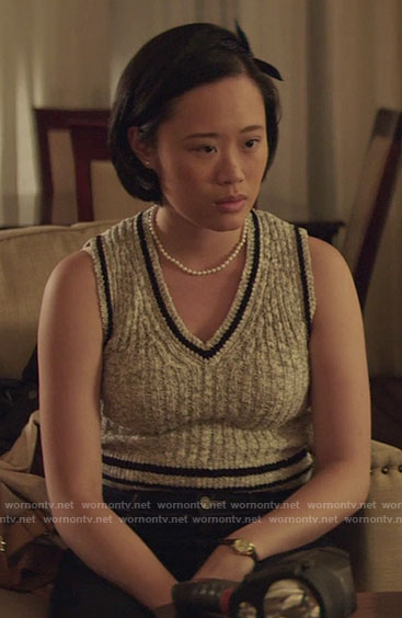 Courtney's grey sleeveless sweater with striped trim on 13 Reasons Why
