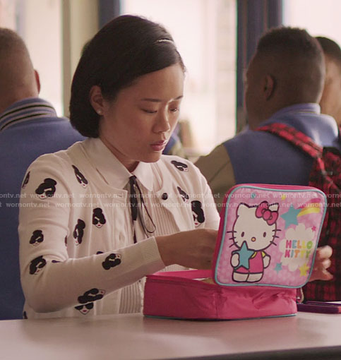 Courtney's white face print cardigan and Hello Kitty lunchbox on 13 Reasons Why
