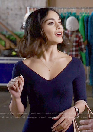 Emily's navy v-neck dress on Powerless