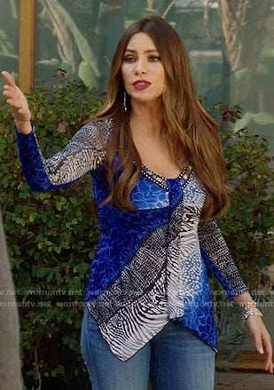 Gloria's blue animal print v-neck top on Modern Family