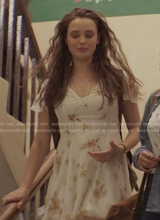 Hannah's white floral v-neck dress on 13 Reasons Why