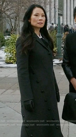Joan's long black coat with asymmetrical buttons on Elementary