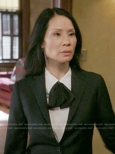 Joan's white top with black tie neck on Elementary
