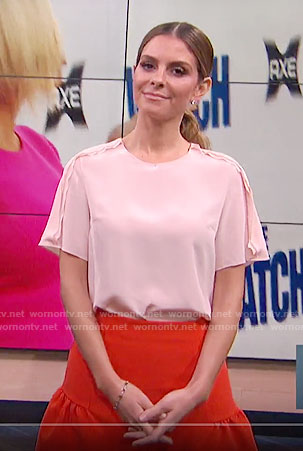 Maria's pink top and red drop waist skirt on E! News